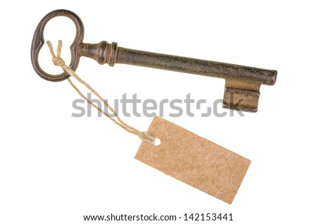 Old key with a tag - stock photo