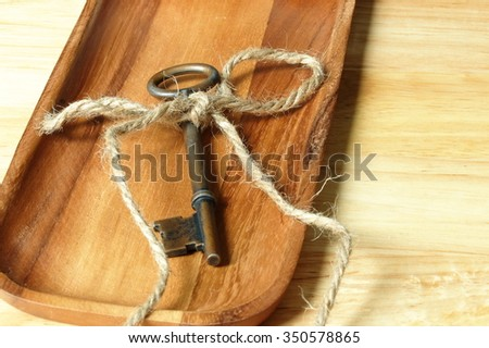 old key with rope