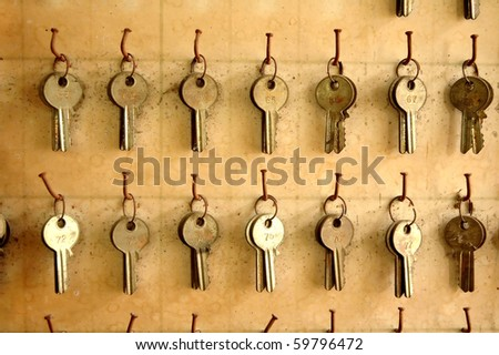 old keys hang on wood Board - stock photo