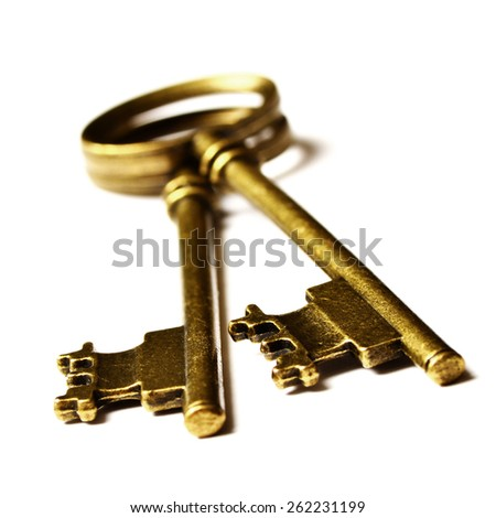 Old keys laying on top of white background isolated - stock photo