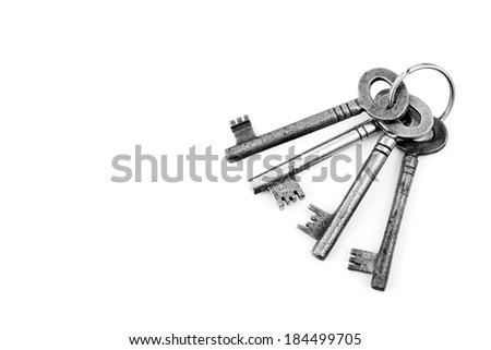 Old keys on a white background - stock photo