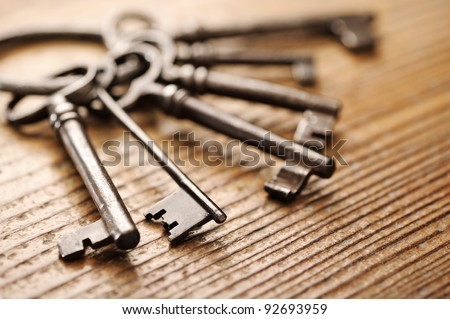 old keys on a wooden table, close-up - stock photo