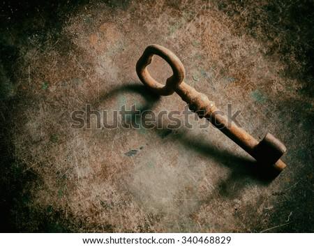 old keys on metal texture. - stock photo