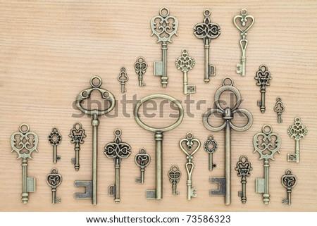 Old keys on wooden background - stock photo