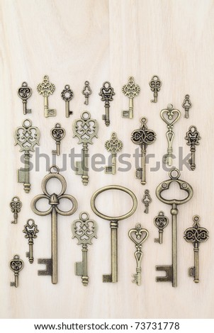 Old keys wooden background - stock photo