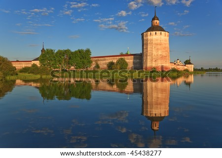 Old Kirillo-Belozersky monastery, towers from lake. Russia - stock photo