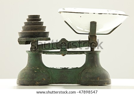Old kitchen scale with metal weights - stock photo