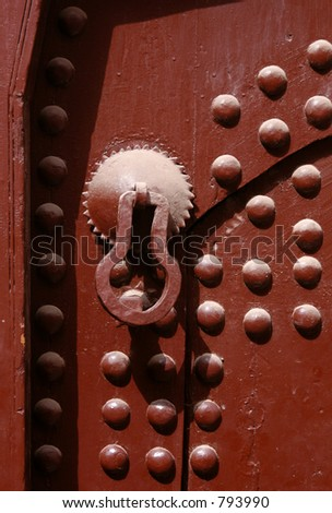 Old knocker on a door of a traditional Moroccan house in Marrakech, Morocco - stock photo