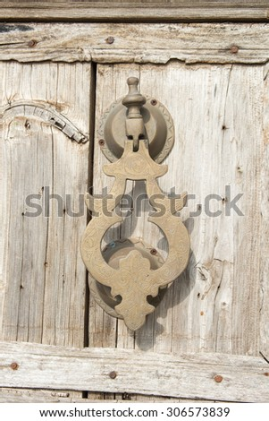 Old knocker on a wood door, Morocco style - stock photo