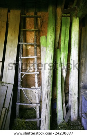 Old ladder in the barn - stock photo