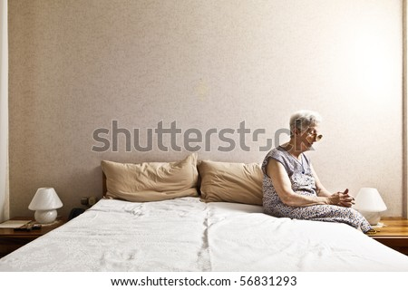 old lady in the bedroom - stock photo