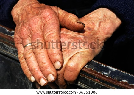 Old lady's hands showing the signs of hard work - stock photo