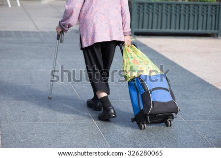 old lady with a cane
