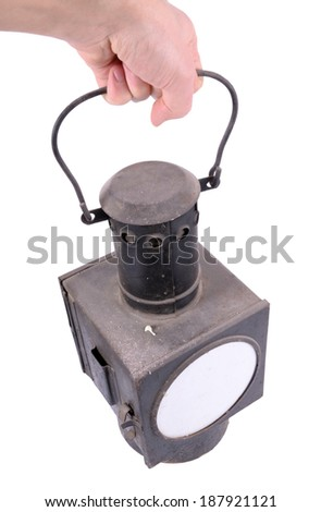 old lamp held in the hand - stock photo