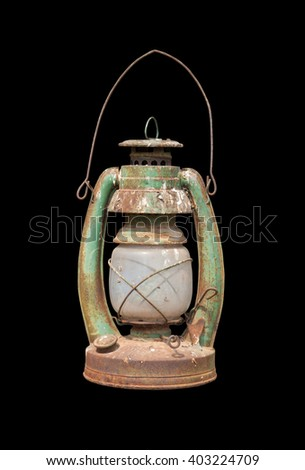 Old lamp isolated on black background. - stock photo