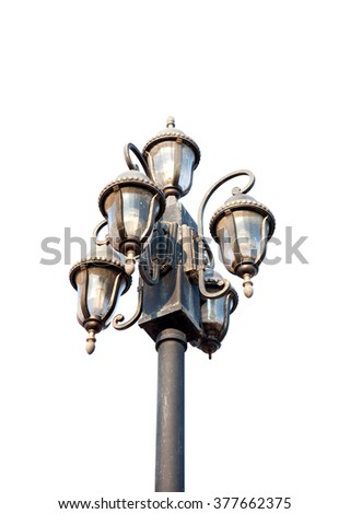 Old Lamp post street road light pole isolated. - stock photo