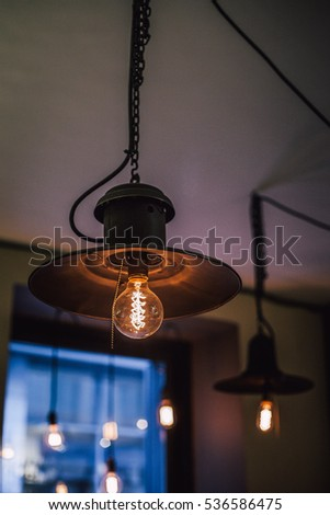 Old lamp with light bulb in coffee shop