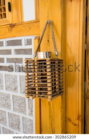 Old lamp, wood lamp. - stock photo