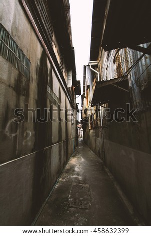 Old Lane, which represents a danger to people.Used film filter for old tone color. - stock photo