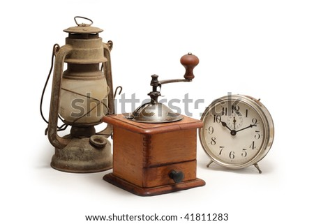 Old lantern, little mill and alarm clock, isolated on white - stock photo