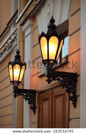 Old lanterns on the wall, Saint Petersburg, Russia - stock photo