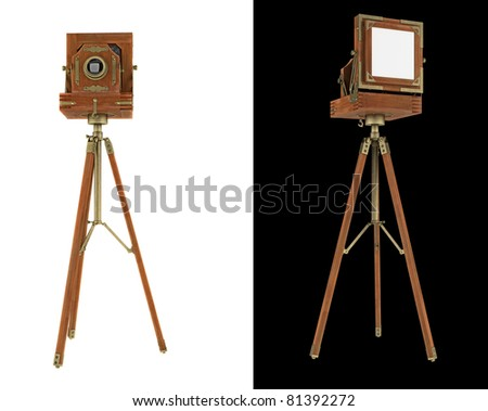 Old large format camera on tripod isolated on white