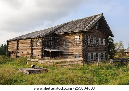 Old large wooden house in northern Russian village - stock photo