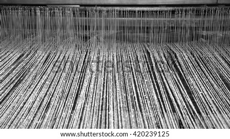 old last century loom in the textile industry for the production of woolen blankets - stock photo