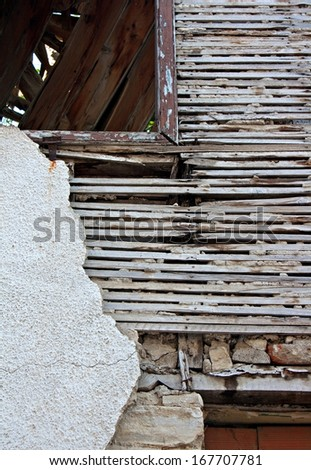 Old lath and plaster on exterior of old derelict house - stock photo