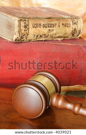 Old law books and judge hammer - stock photo
