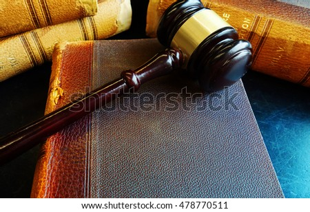 Old law books with court gavel