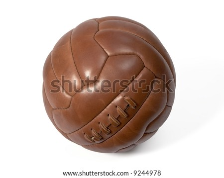 Old leather ball to play soccer. - stock photo
