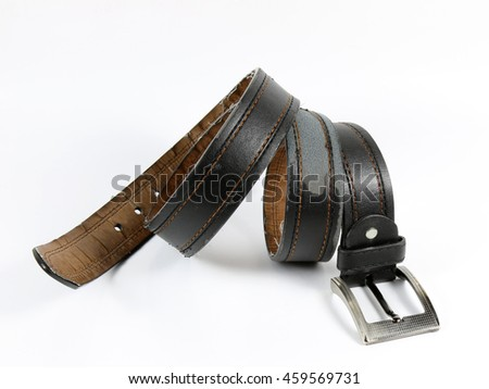 Old leather belt with buckle on white background