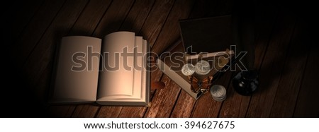 old leather book with quill and inkwell on wooden table in candlelight