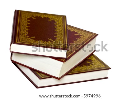 Old leather bound decorative books isolated on a white background - stock photo