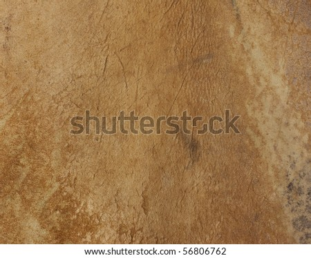 Old leather from cowboy chaps. Some grunge intact. - stock photo