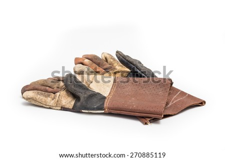 Old leather gloves on white background. - stock photo