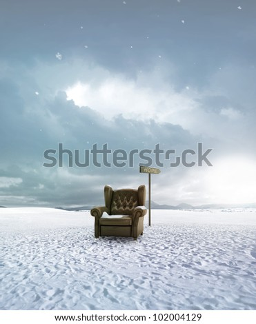 Old leather seat abandoned in the snow land and arrow indicates the hop - stock photo