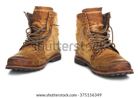Old leather shoes - stock photo
