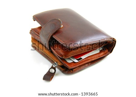 Old leather wallet full of credit cards on white background - stock photo