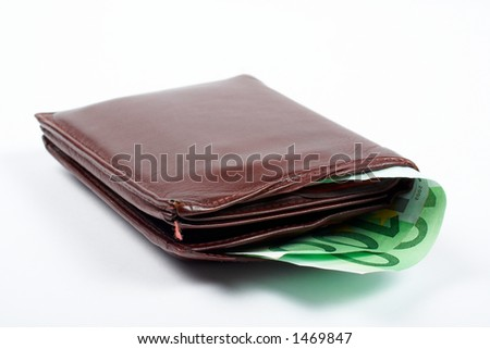 Old leather wallet with bills inside, isolated on white background