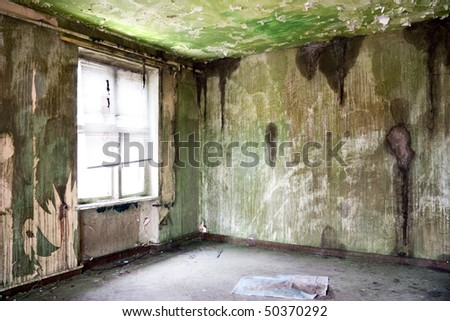 old leave deserted room with window - stock photo
