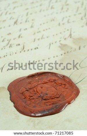 Old letter with a red wax seal. - stock photo