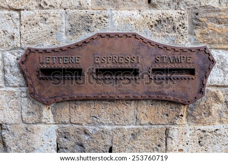 Old letterbox in Italy - stock photo