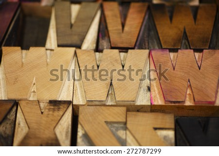 Old letterpress capital letters in a bold font - stock photo