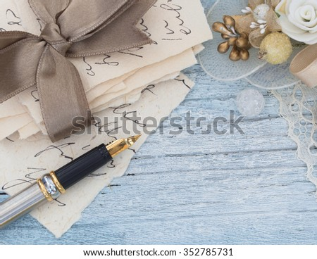 old letters and pen in the vintage arrangement