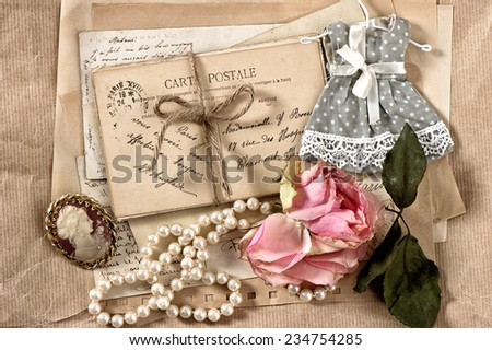 old letters, postcards, dry rose flower and vintage things. nostalgic sentimental background - stock photo