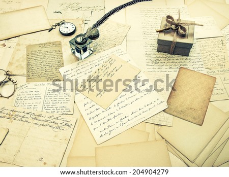 old letters, vintage postcards and antique feather pen. nostalgic sentimental background. retro style toned picture - stock photo