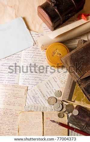 Old letters with various things - stock photo