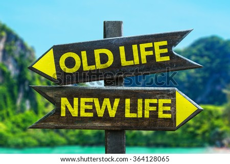 Old Life - New Life signpost in a beach background - stock photo